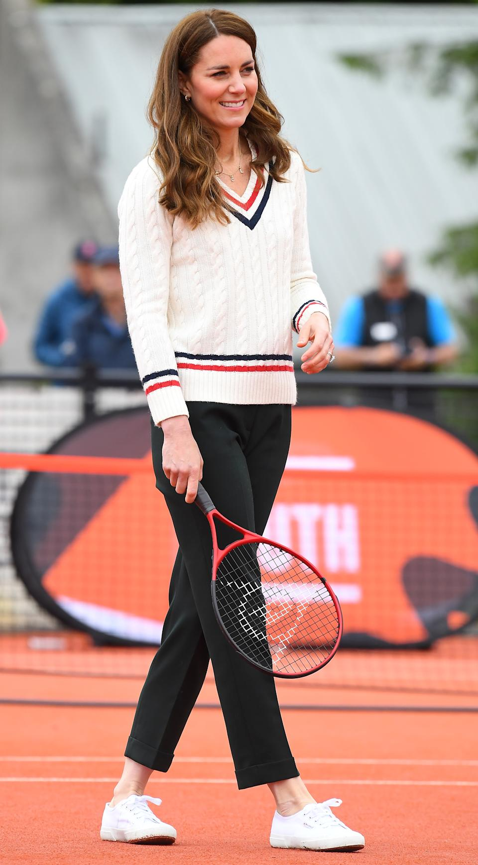 Kate Middleton looked sporty-chic wearing Supergas Cotu Sneakers during a visit to a tennis club in Edinburgh, Scotland. (Image via Getty Images)