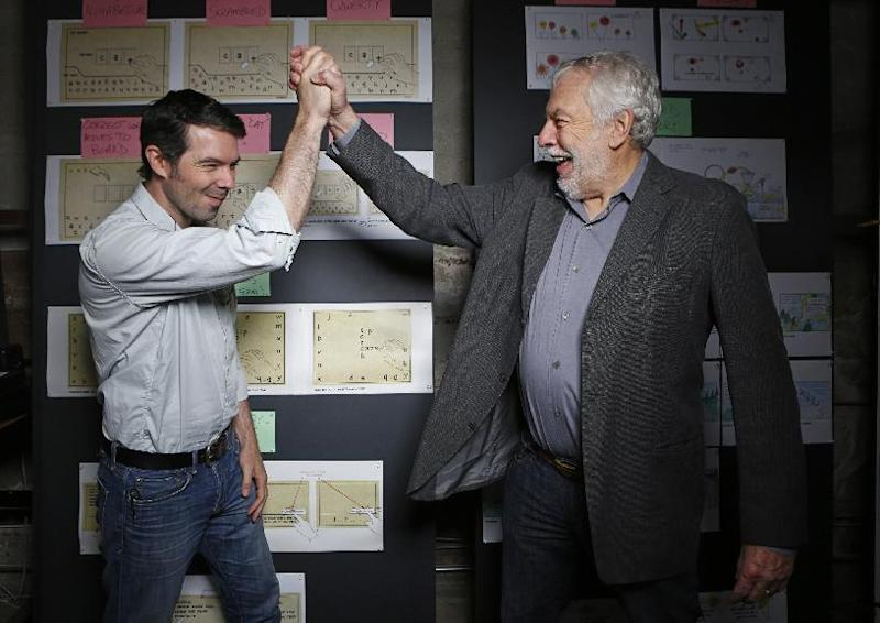 "In this photo taken Wednesday, Mar. 20, 2013, Nolan Bushnell, the founder of Atari, right cheers his son, Brent Bushnell, CEO of   ""Two-Bits-Circus,""  a Los Angeles idea factory focused on software, hardware and machines. Nolan Bushnell was the first guy to give Steve Jobs his first full-time job in Silicon Valley at Atari. Two Bit Circus is a unique hybrid of intellectuals, creatives and performers. (AP Photo/Damian Dovarganes)"