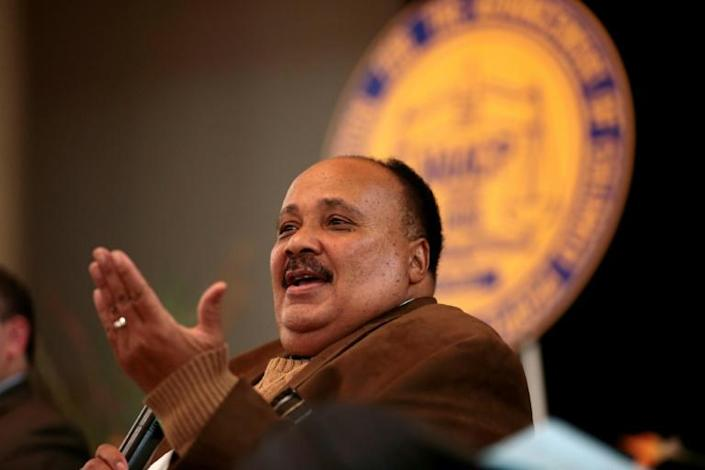 Martin Luther King III, speaking during the NAACP General Membership Meeting in Detroit, Michigan, is seeking to inspire the black community into political activism (AFP Photo/JEFF KOWALSKY)