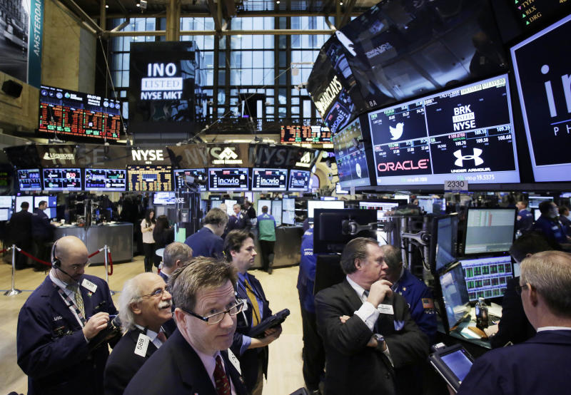 Traders monitor stock prices at the New York Stock Exchange, Wednesday, Feb. 12, 2014. U.S. stocks are edging higher in early trading as the market extends its longest winning streak of the year. (AP Photo/Mark Lennihan)