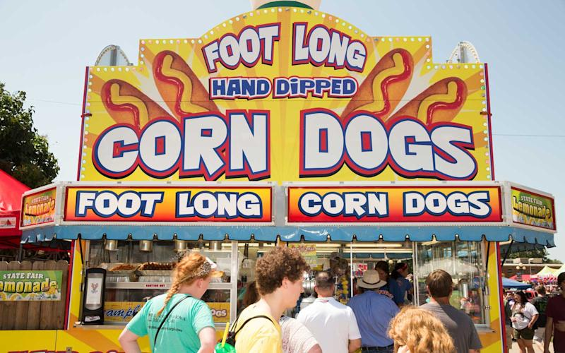 Don't come to the fair unless you're prepared to loosen your belt buckle. From Foot Long Corn Dogs (pictured here), to pork on a stick, to an endless array of deep fried everything (vegetables to Oreos), you're sure to find a fix for all your fair cravings. | Jason Bergman