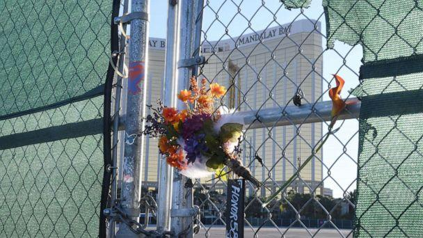 PHOTO: Flowers and a sign reading 'HONOR 58' hang on a fence outside the Las Vegas Village across from Mandalay Bay Resort and Casino as a tribute to those killed almost two years ago in a massacre at the site on Sept. 30, 2019, in Las Vegas. (Ethan Miller/Getty Images)