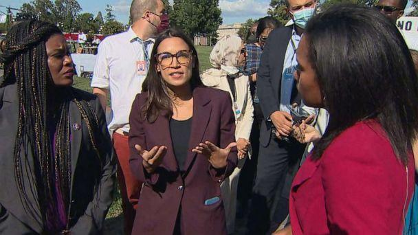 PHOTO: Reps. Alexandria Ocasio-Cortez and Cori Bush, left, talk about Sen. Joe Manchin demanding that Democrats trim the size and scale of their social spending proposal to win his support, Sept. 30, 2021, outside the U.S. Capitol. (ABC News)