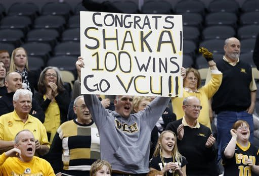 Virginia Commonwealth fans hold up a sign congratulating VCU head coach Shaka Smart after the NCAA college basketball game against Duquesne on Saturday, Jan. 19, 2013, in Pittsburgh. VCU won 90-63. (AP Photo/Keith Srakocic)