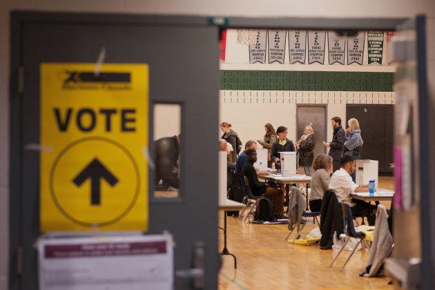 Voters cast ballots on election day in Toronto on Oct. 19, 2015.