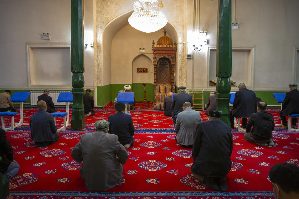 Uyghurs and other members of the faithful pray during services at the Id Kah Mosque in Kashgar in western China's Xinjiang Uyghur Autonomous Region, as seen during a government organized visit for foreign journalists on April 19, 2021. Under the weight of official policies, the future of Islam appears precarious in Xinjiang, a remote region facing Central Asia in China's northwest corner. Outside observers say scores of mosques have been demolished, which Beijing denies, and locals say the number of worshippers is on the decline. (AP Photo/Mark Schiefelbein)