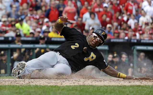 Pittsburgh Pirates' Marlon Byrd scores on a sacrifice fly by Russell Martin in the seventh inning of Game 2 in baseball's National League division series against the St. Louis Cardinals on Friday, Oct. 4, 2013, in St. Louis. (AP Photo/Jeff Roberson)