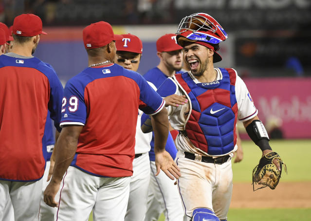 Texas Rangers catcher Robinson Chirinos, right, jokes with Adrian Beltre (29) after the Rangers' 8-6 win over the Los Angeles Angels in a baseball game Thursday, Aug. 16, 2018, in Arlington, Texas. (AP Photo/Jeffrey McWhorter)