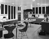 """<p>By the mid-century, the kitchen had become a stylish gathering space. In 1953, <em>House Beautiful</em> wrote about this new era: """"The best measure of the revolution in the food world is that the kitchen has become a presentable living room. The kitchen has changed because the work done there is different, and because modern materials can look beautiful — yet still be practical."""" This combo kitchen and dining area elegantly proves the point.</p>"""