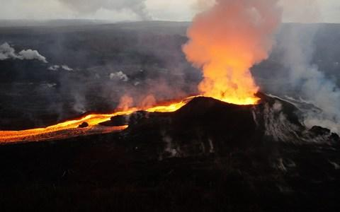 An early morning view of fissure 8 and lava channel looking toward the east - Credit: AFP