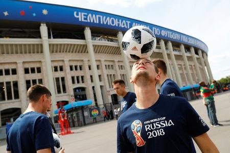 Soccer Football - World Cup - Group A - Russia vs Saudi Arabia - Luzhniki Stadium, Moscow, Russia - June 14, 2018 A football freestyle artists performs outside the stadium before the match REUTERS/Kai Pfaffenbach