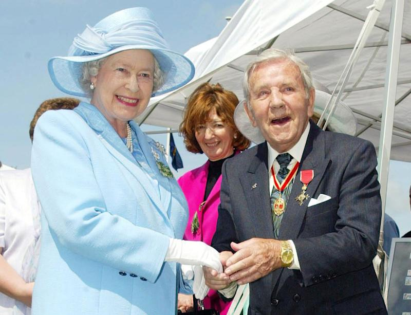 Queen Elizabeth II meets comedian Sir Norman Wisdom, during her visit to the Isle of Man in 2003 (Phil Noble/PA Archive/PA Images)