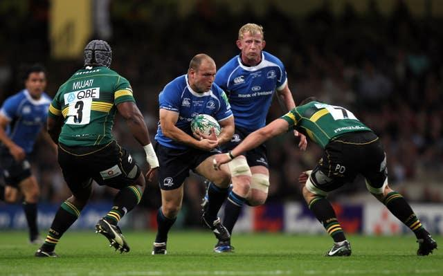 Leinster's Richard Strauss runs into the tackle of Northampton's Phil Dowson during the Heineken Cup final in Cardiff