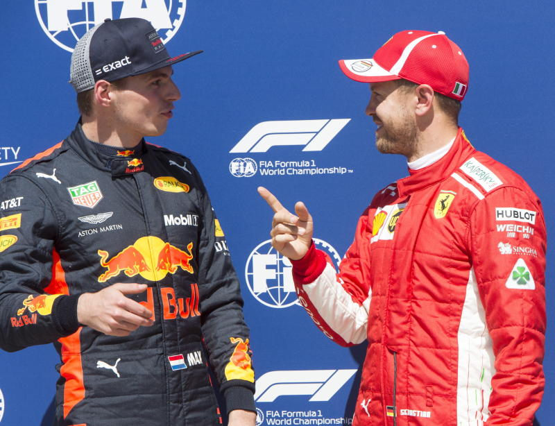 Pole sitter Ferrari driver Sebastian Vettel right of Germany chats with third place finisher Red Bull driver Max Verstappen of Netherlands after the qualifying session for the F1 Canadian Grand Prix auto race Saturday