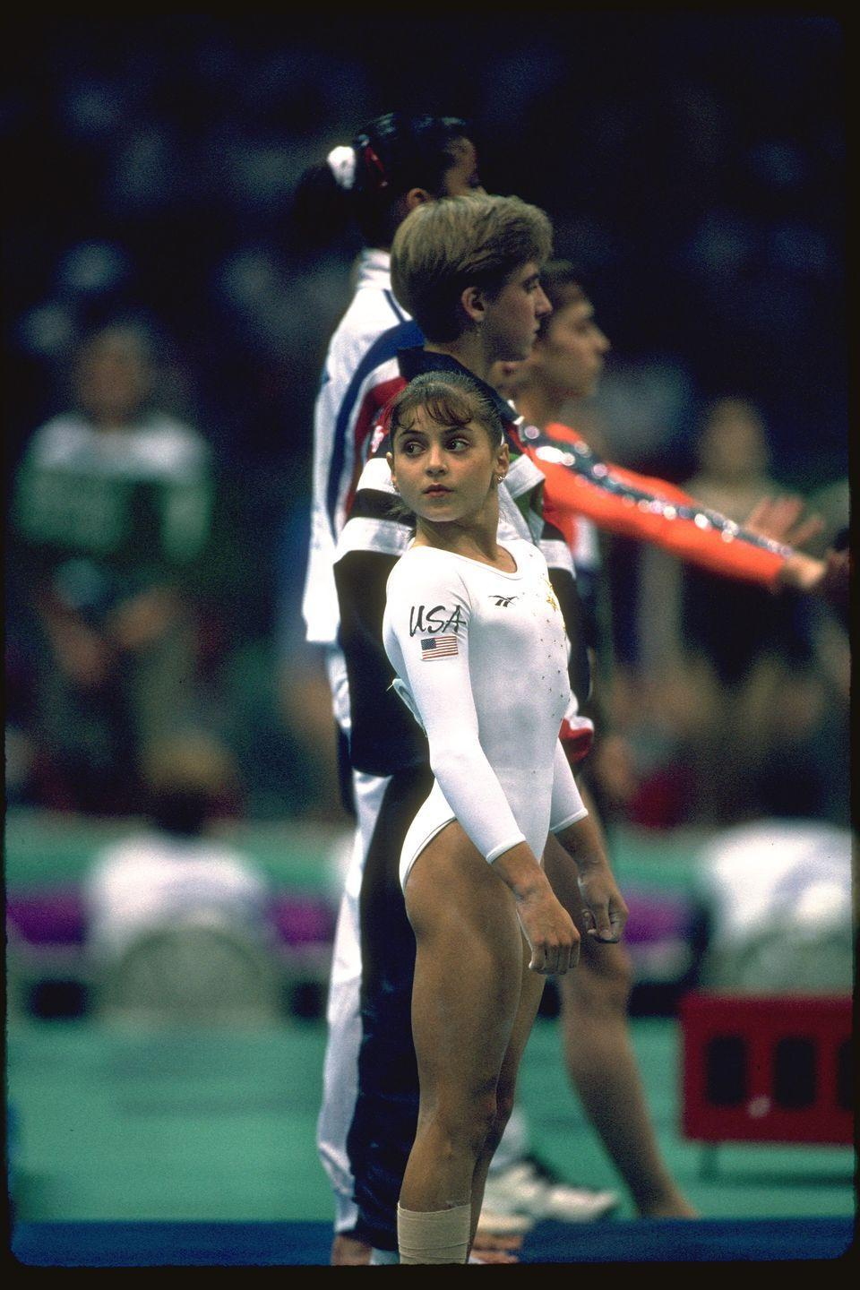 <p>Dominique Moceanu competed in the 1996 Atlanta Olympic Games on the Magnificent Seven and at just 14 years old, she became the youngest Olympic competitor to win a gold medal. </p>