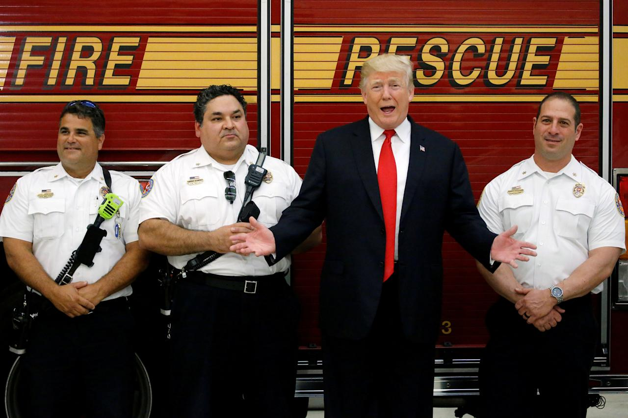 <p>U.S. President Donald Trump greets members of the West Palm Beach Fire Rescue squads at one of their stations in West Palm Beach, Florida, U.S. December 27, 2017. REUTERS/Jonathan Ernst TPX IMAGES OF THE DAY </p>