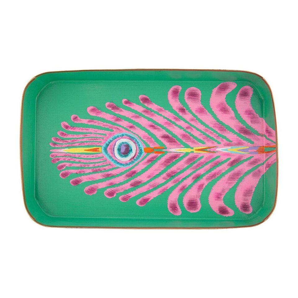 """<p>The homeware label Les Ottomans draws on its founder Bertrando Di Renzo's years of travels, and its collaboration with Matthew Williamson sees the coming together of colour and style. This hand-painted iron tray dons a feather pattern in pinks and turquoise, that is set against a grassy green. FC</p><p>£85, <a href=""""https://www.amara.com/products/matthew-williamson-iron-tray-rectangular-green?utm_source=google&utm_medium=cpc&amss=l91&&pdg=pla-851209172337:kwd-851209172337:cmp-1527429833:adg-62048942767:crv-289893345598:pid-181633:dev-c&gclid=CjwKCAjwj6SEBhAOEiwAvFRuKNjrva6XxhzEl7ASArTSnG2AqivSsqG8M9PgZ9NzJN2jM6HLWfh9TRoCF7IQAvD_BwE&gclsrc=aw.ds"""" rel=""""nofollow noopener"""" target=""""_blank"""" data-ylk=""""slk:Amara"""" class=""""link rapid-noclick-resp"""">Amara</a>.</p>"""