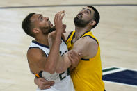 Indiana Pacers center Goga Bitadze, right, and Utah Jazz center Rudy Gobert (27) battle for position under the boards in the first half of an NBA basketball game Friday, April 16, 2021, in Salt Lake City. (AP Photo/Rick Bowmer)