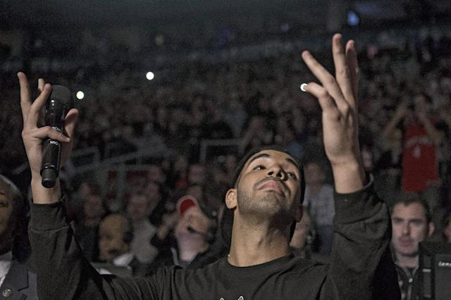 Rapper Drake introduces the Toronto Raptors over the public address system ahead of their 96-80 win over Brooklyn Nets during an NBA basketball game, Saturday, Jan. 11, 2014 in Toronto (AP Photo/The Canadian Press, Chris Young)