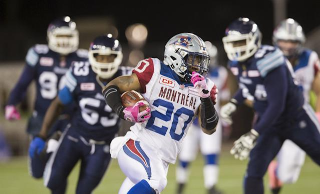 Montreal Alouettes' Tyrell Sutton runs the ball against the Toronto Argonauts during the first half of their CFL football game in Hamilton, Ontario, Canada, October 23, 2015. The game was moved from the Rogers Centre in Toronto to Hamilton at Tim Hortons Field due to scheduling conflicts with the Toronto Blue Jays baseball playoffs schedule. REUTERS/Mark Blinch