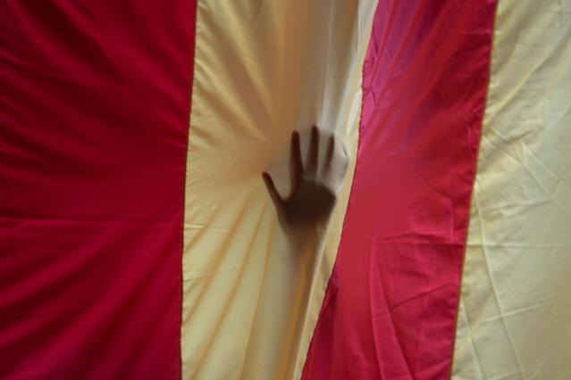 <p>A hand is seen through a giant Estelada (Catalan separatist flag) in the University of Barcelona's historic building a day before the banned Oct. independence referendum in Barcelona, Spain, Sept. 30, 2017. (Photo: Enrique Calvo/Reuters) </p>