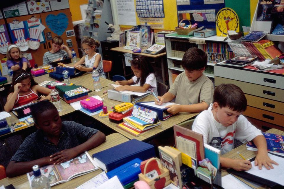 <p>Second grade students reading and writing in class at their year-round school in San Diego. </p>