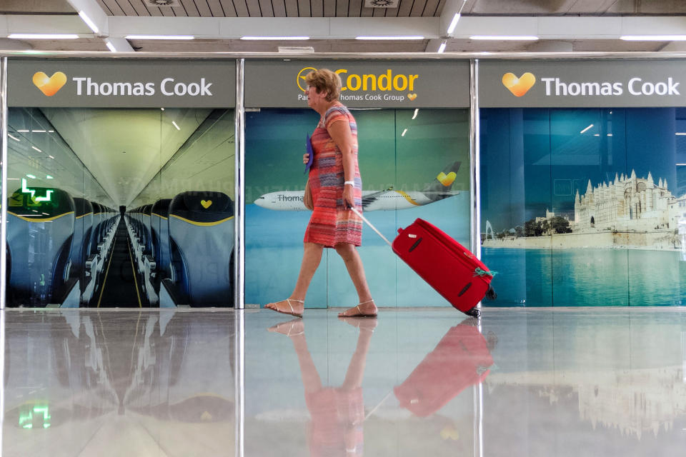 A passenger walks past a closed Thomas Cook office at Palma de Mallorca airport on Monday, Sept. 23, 2019. Spain's airport operator AENA says that 46 flights have been affected by the collapse of the British tour company Thomas Cook, mostly in the Spanish Balearic and Canary archipelagos. (AP Photo/Francisco Ubilla)
