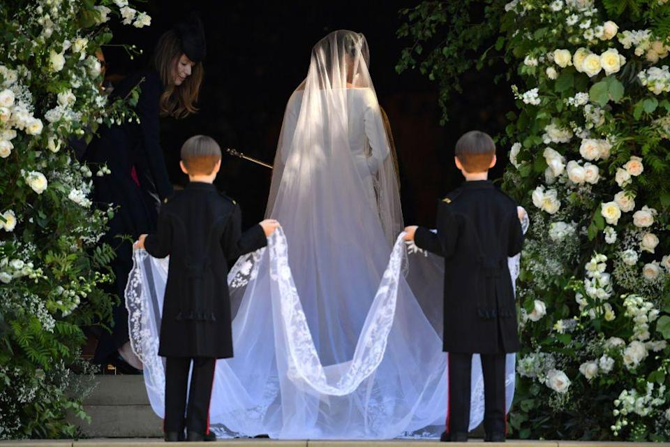 """<p>Pictured here is Meghan Markle's famous wedding look from her 2018 wedding to Prince Harry. Her Givenchy gown featured no beading or embroidery, creating further emphasis on her dramatic veil. </p><p>""""Ms. Markle expressed the wish of having all 53 countries of the Commonwealth with her on her journey through the ceremony. Ms. Waight Keller designed a veil representing the distinctive flora of each Commonwealth country united in one spectacular floral composition,"""" Kensington Palace <a href=""""https://twitter.com/KensingtonRoyal/status/997794737645113344?tfw_site=TIME&ref_src=twsrc%5Etfw&ref_url=http%3A%2F%2Ftime.com%2F5278008%2Fmeghan-markle-wedding-tiara%2F"""" rel=""""nofollow noopener"""" target=""""_blank"""" data-ylk=""""slk:tweeted"""" class=""""link rapid-noclick-resp"""">tweeted</a>.</p>"""