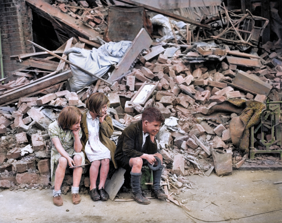 <p>Three children sit by what remains of their home following an overnight attack in East London. (MediaDrumWorld) </p>