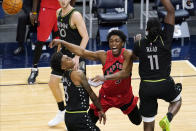 Toronto Raptors' Stanley Johnson (5) gets off a pass from between Minnesota Timberwolves' Jaden McDaniels (3) and Naz Reid (11) during the second half of an NBA basketball game Friday, Feb. 19, 2021, in Minneapolis. (AP Photo/Jim Mone)