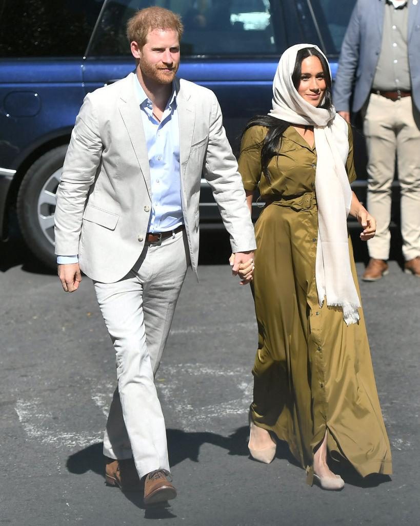 The Duke and Duchess of Sussex arrived at Auwal Mosque hand-in-hand [Photo: Getty]