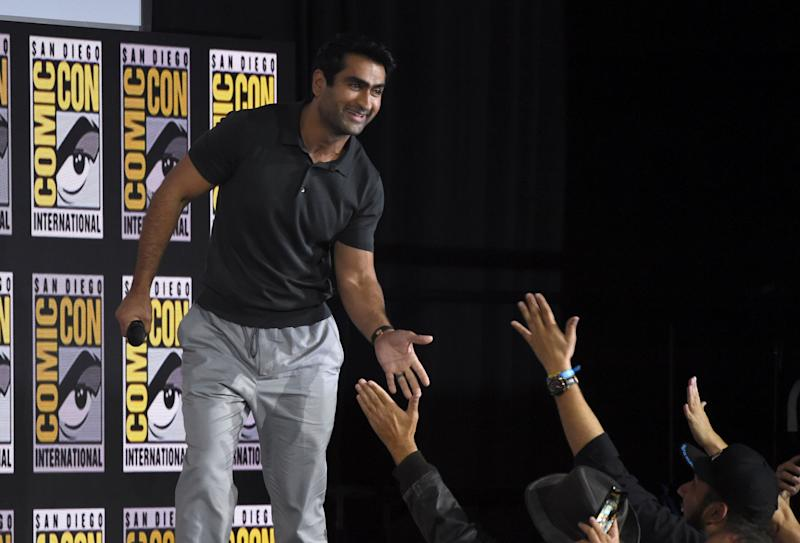 Kumail Nanjiani high-fiving fans on Saturday at San Diego Comic-Con. (Photo: Chris Pizzello/Invision/AP)