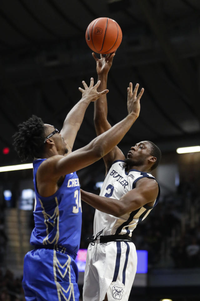 Butler guard Kamar Baldwin (3) shoots over Creighton guard Denzel Mahoney (34) in the first half of an NCAA college basketball game in Indianapolis, Saturday, Jan. 4, 2020. Butler defeated Creighton 71-57. (AP Photo/Michael Conroy)