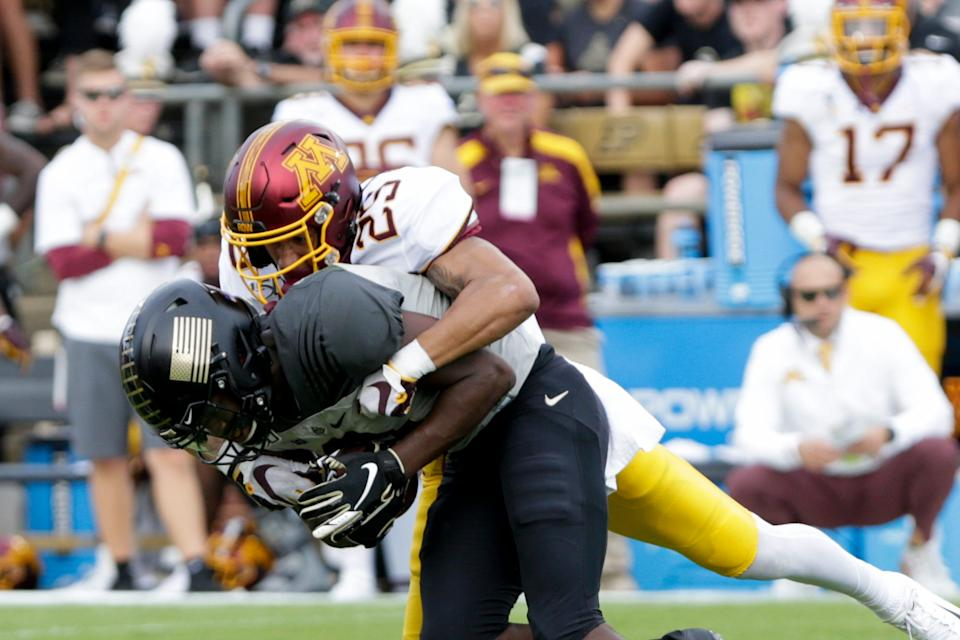 Minnesota defensive back Benjamin St-Juste (25) tackles Purdue wide receiver David Bell (3) during the second quarter of a NCAA football game, Saturday, Sept. 28, 2019 at Ross-Ade Stadium in West Lafayette.