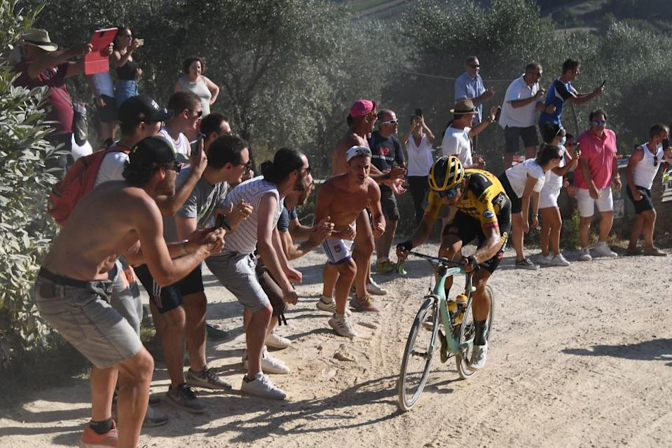 Team JumboVisma Belgian rider Wout van Aert pedal during a break away through a dusty gravel road in the oneday classic cycling race Strade Bianche White Roads on August 1 2020 around Siena Tuscany Photo by Marco Bertorello  AFP Photo by MARCO BERTORELLOAFP via Getty Images