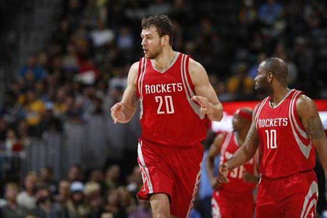 Donatas Motiejunas will remain with the Rockets. (AP)