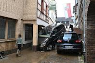 Residents in the worst-hit areas of Germany were gradually returning to scenes of destruction