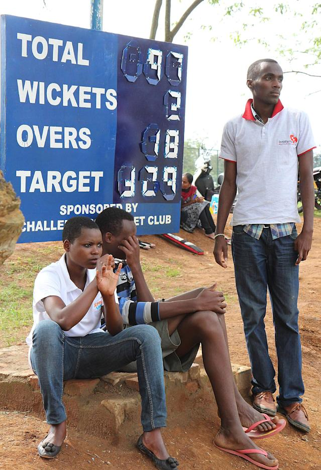 Enthusiasts watch a cricket game on September 7, 2014 at ETO Kicukiro, the former technical school of Kigali where thousands of Rwandans were killed during the 1994 genocide (AFP Photo/Stephanie Aglietti)