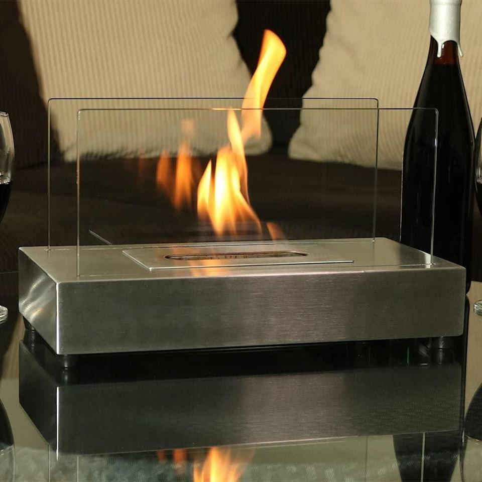 <p>Looking for a minimalist design? This <span>Regal Flame Avon Ventless Indoor Outdoor Fire Pit</span> ($84) is for you.</p>