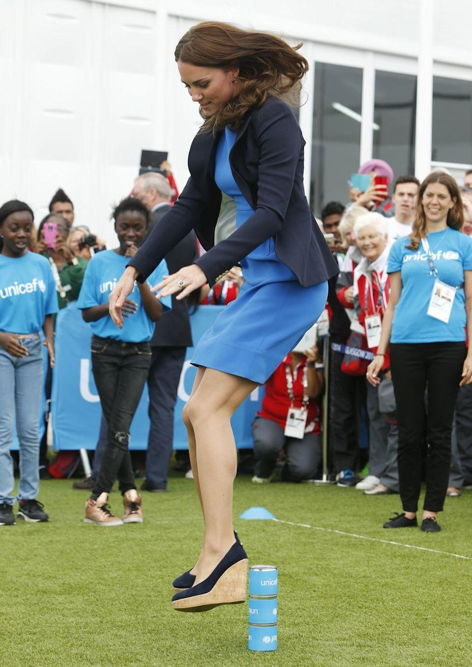 <p>While not exactly dressed for jumping, the Duchess looked quite chic playing Three Tins, a traditional South African game. Kate joined in the fun at the Commonwealth Games Village in Glasgow, Scotland. </p>
