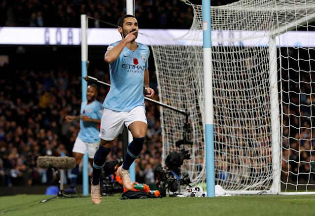 """Soccer Football - Premier League - Manchester City v Manchester United - Etihad Stadium, Manchester, Britain - November 11, 2018 Manchester City's Ilkay Gundogan celebrates scoring their third goal REUTERS/Darren Staples EDITORIAL USE ONLY. No use with unauthorized audio, video, data, fixture lists, club/league logos or """"live"""" services. Online in-match use limited to 75 images, no video emulation. No use in betting, games or single club/league/player publications. Please contact your account representative for further details."""