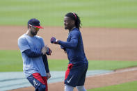 Atlanta Braves' Ronald Acua Jr., right, and Ender Inciarte, left, horseplay during team practice at Truist Park on Sunday, July 5, 2020, in Atlanta. (AP Photo/Brynn Anderson)