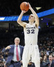 Xavier's Ryan Welage shoots in the first half of an NCAA college basketball game against St. John's, Saturday, March 9, 2019, in Cincinnati. (AP Photo/John Minchillo)