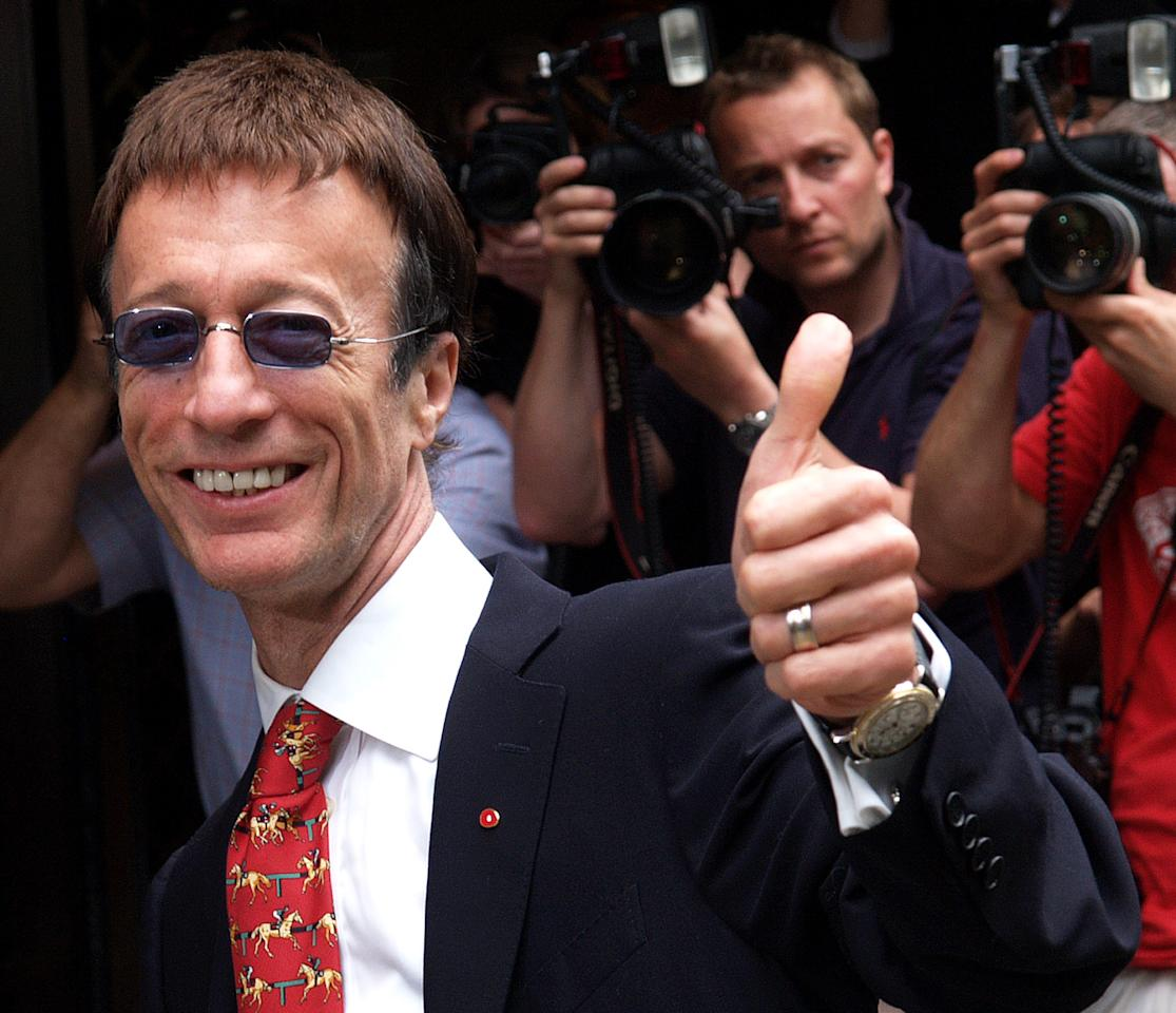 FILE - In this May 24, 2007, file photo, Robin Gibb of The Bee Gees arrives at Grosvenor House in London, to attend the Ivor Novello Awards. A representative said on Sunday, May 20, 2012, that Gibb has died at the age of 62. (AP Photo/Max Nash, File)