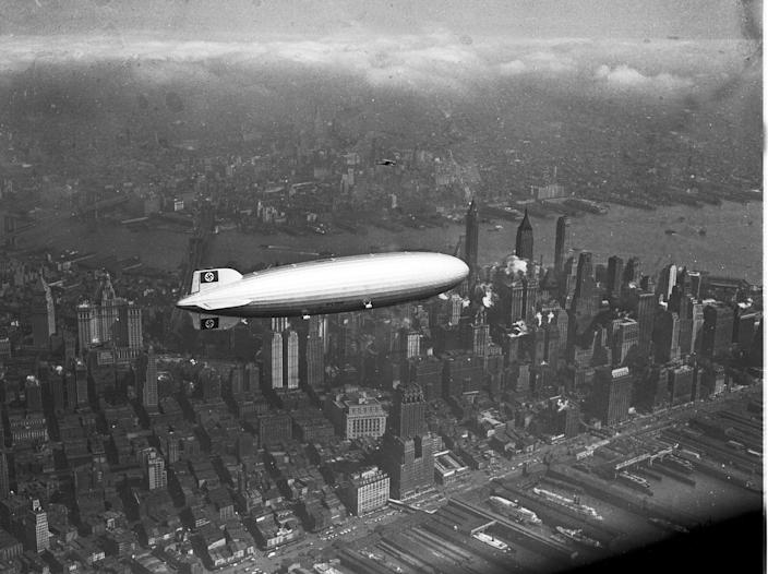 <p>The German zeppelin Hindenburg flies over Manhattan on May 6, 1937. A few hours later, the ship burst into flames in an attempt to land at Lakehurst, N.J. (AP Photo) </p>
