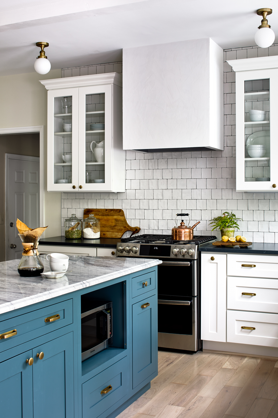 "<p>Try painting your kitchen island a striking color like <a href=""https://www.alisongieseinteriors.com/portfolio-unique-interior-design-northern-virginia"" rel=""nofollow noopener"" target=""_blank"" data-ylk=""slk:Alison Giese Interiors"" class=""link rapid-noclick-resp"">Alison Giese Interiors</a> did on this project. We love how it stands out and contrasts the other white cabinets.</p>"