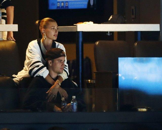 Justin Bieber and wife Hailey Rhode Bieber watch Game Seven of the Eastern Conference First Round during the 2019 NHL Stanley Cup Playoffs between the Boston Bruins and the Toronto Maple Leafs at TD Garden on April 23, 2019 in Boston, Massachusetts.