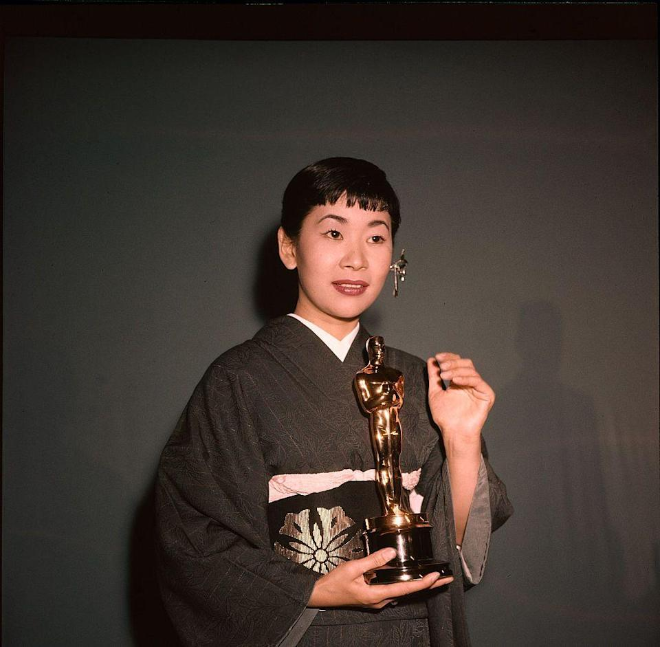 <p>The Japanese-American star wore a beautiful traditional kimono when she picked up her Best Supporting Actress award for her role in <em>Sayonara</em>. She was the first Asian performer to win an Oscar.</p>