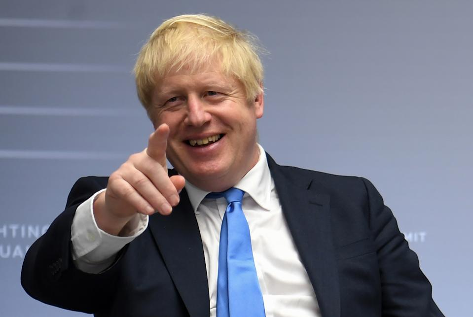 Britain's Prime Minister Boris Johnson gestures after a bilateral meeting with Japan's Prime Minister Shinzo Abe during the annual G7 summit in Biarritz, south-western France on August 26, 2019. (Photo by NEIL HALL / POOL / AFP)        (Photo credit should read NEIL HALL/AFP/Getty Images)