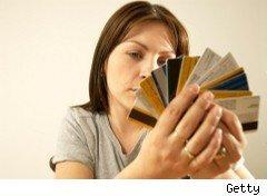 Woman holds an array of credit cards